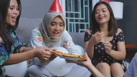 indonesian : friends enjoying brithday party and singing together