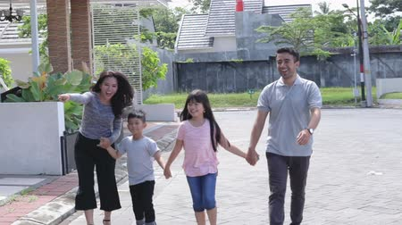 happy : young happy asian family walking together