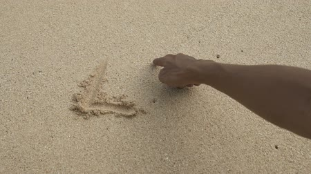 kumul : hands writting a word life on sand beach