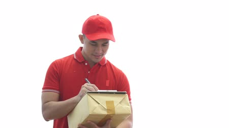 почтальон : delivery man holding parcel boxes while signing the document