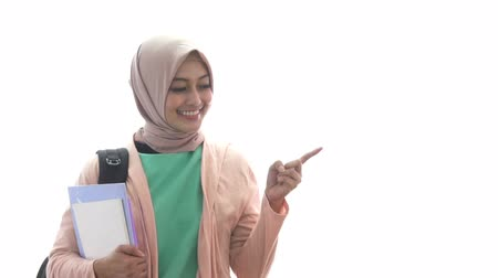 medical student : beautiful medical student holding books while pointing at copy s Stock Footage