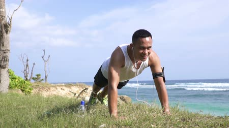 beach panorama : sporty young man push up Stock Footage