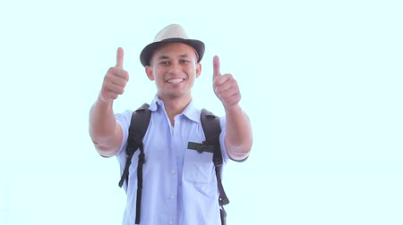 hátizsákkal : a backpacker giving thumbs up and then double thumbs up