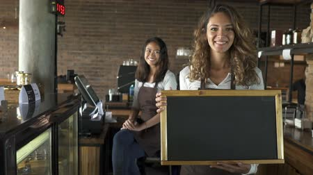 caixa : woman waiter holding blackboard