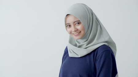 scholar : Woman veiled standing with smiling look at camera
