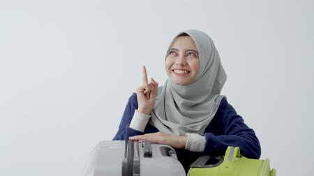 bilet : muslim woman with hijab pointing up