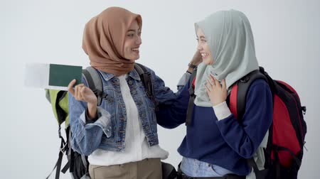 bilet : asian muslim woman backpacker isolated