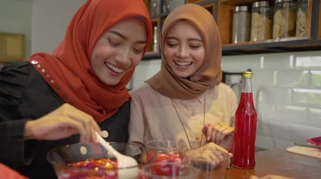 lebaran : women hijab prepare fresh drink cocktail