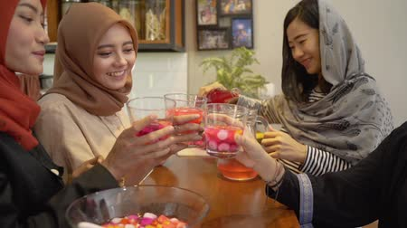 lebaran : hijab women and friends breaking fast