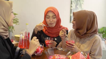 vasten : hijab women and friends breaking fast