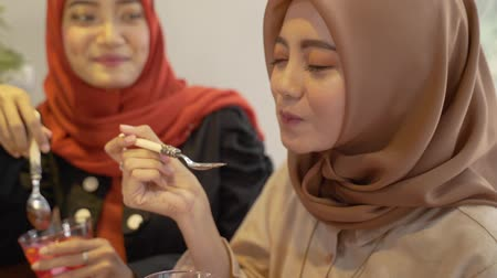 lebaran : hijab women enjoy sweet drink when breaking fast together Stock Footage