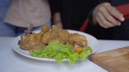 lebaran : hand preparing food  fried chicken Stock Footage