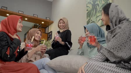 lebaran : Veiled young women enjoy together a fruits cocktail