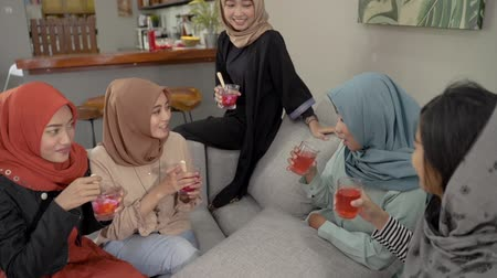 lebaran : Veiled women drink cheers when breaking their fast