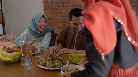 lebaran : The muslim family together enjoy the iftar meal