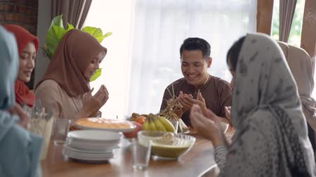 lebaran : family prayed together before breaking the fast