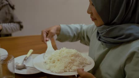 malaya : asian muslim woman eating rice