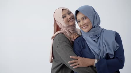 lebaran : Asian hijab woman hugs her mother for loving her