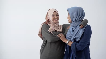 lebaran : Asian hijab woman hugs her mother sign of love each other