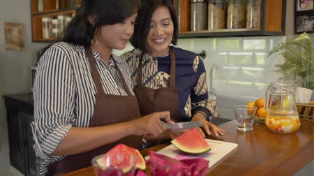 lebaran : woman make sweet drink from fruits Stock Footage