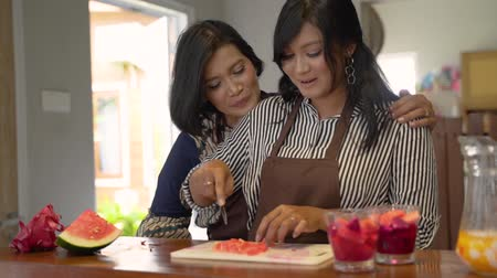 lebaran : Two asian woman cooking in the kitchen Stock Footage