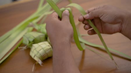 rice cake : Close up of hands man make traditional ketupat food Stock Footage