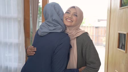 lebaran : daughter and mother greet each other apologizing