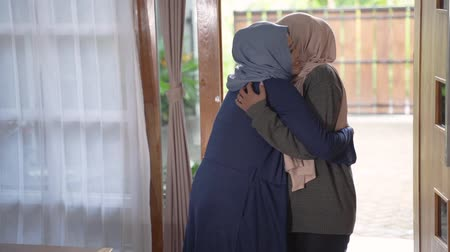 lebaran : daughter and mother embraced when her daughter returned home