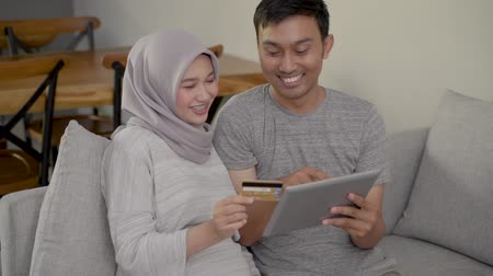tab : muslim couple buy and do payment using credit card Stock Footage