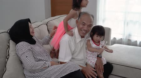 parentes : grandparent and granddaughter having fun playing together