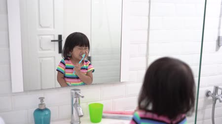 preventive : toddler independently brush her own teeth
