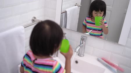 preventive : kid wash her mouth or gargle