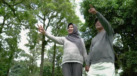 finom : muslim senior couple relaxing in the park