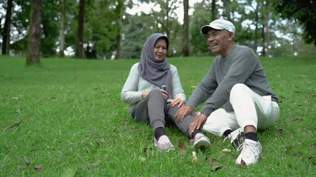 cramps : old couple having some massage while sitting in the park