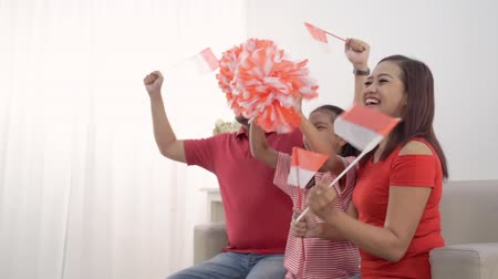 augusto : indonesian family holding indonesia flag over white background