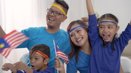 excited malaysian sport fans supporter