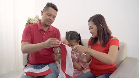 augusto : family indonesia celebrating independence day