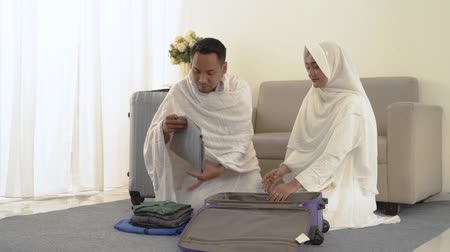muslim family preparing luggage before hajj