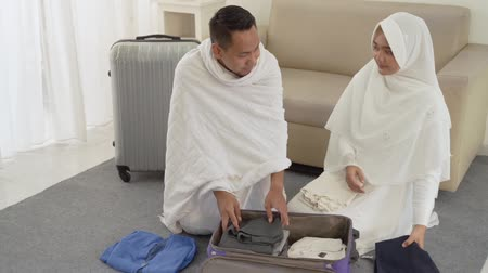 hacı : muslim family preparing luggage before hajj