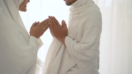shake hand wife kiss husbands hand after praying