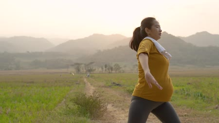 pregnant woman exercising outdoor