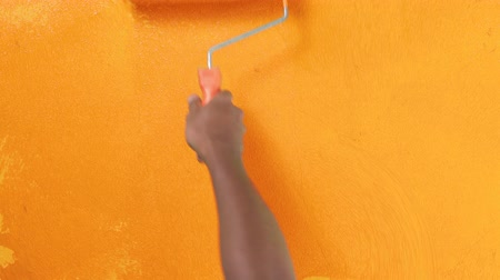 tutmak : Footage roller for painting walls with orange paint on the wall