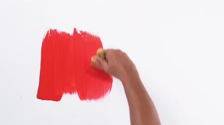 tutmak : footage hand red painting with brush with texture isolated