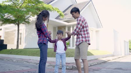 family and kid enjoy playing together in front of their house Wideo