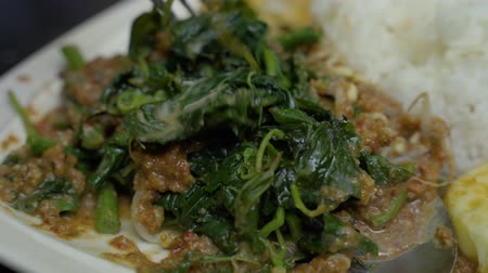 frijoles : mix of traditional food pecel with peanuts sauces stirred with a fork