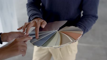 catalog : hands hold a catalog of paint samples show to customers Stock Footage