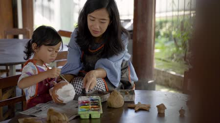 clay pot : mother and daughter making ceramic pot Stock Footage