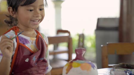 shaping : asian child painting ceramic pot