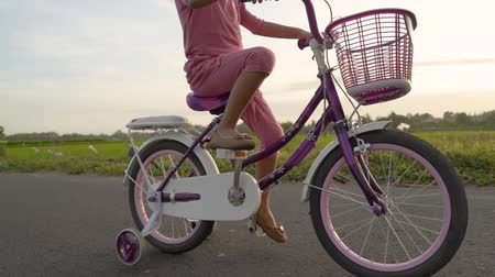 balanço : toddler enjoy riding her bicycle outdoor