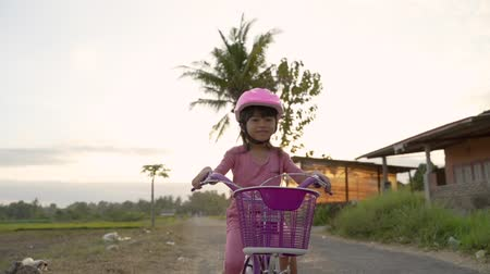 independente : happy kid girl riding her bicycle outdoor